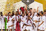 Hasan Al Haydos of Qatar (C) rises the trophy with Qatar team during the AFC Asian Cup UAE 2019 Final match between Japan (JPN) and Qatar (QAT) at Zayed Sports City Stadium  on 01 February 2019 in Abu Dhabi, United Arab Emirates. Photo by Marcio Rodrigo Machado / Power Sport Images
