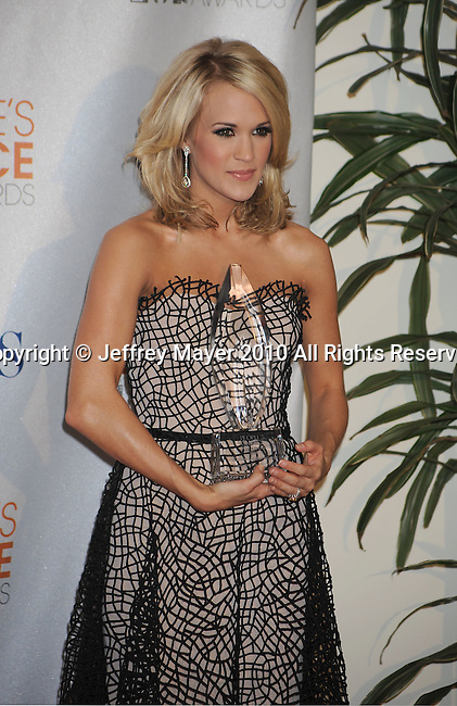 LOS ANGELES, CA. - January 06: Carrie Underwood poses in the press room at the People's Choice Awards 2010 held at Nokia Theatre L.A. Live on January 6, 2010 in Los Angeles, California.
