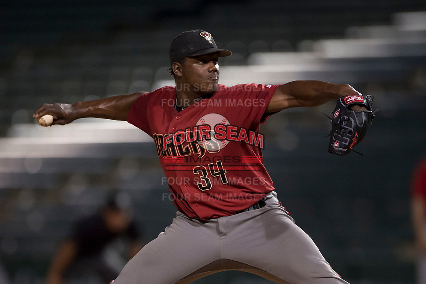 AZL Diamondbacks relief pitcher Juan Araujo (34) delivers a pitch during an Arizona League game against the AZL Angels at Tempe Diablo Stadium on June 27, 2018 in Tempe, Arizona. The AZL Angels defeated the AZL Diamondbacks 5-3. (Zachary Lucy/Four Seam Images)