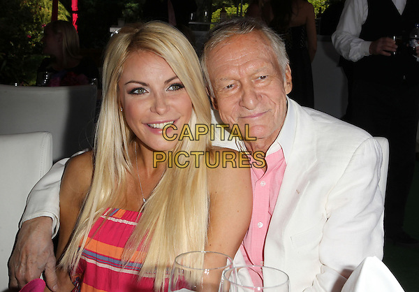 Crystal Harris Hefner, Hugh Hefner.Playboy's 2013 Playmate Of The Year Luncheon Honoring Raquel Pomplun Held At The Playboy Mansion, Hombly Hills, California, .USA, 9th May 2013..half length arm around sitting wife of Hugh Hefner strapless pink striped orange white suit shirt couple married husband .CAP/ADM/KB.©Kevan Brooks/AdMedia/Capital Pictures