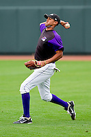 Right fielder Jose Martinez #40 of the Winston-Salem Dash makes a throw during fielding practice at BB&T Ballpark on May 7, 2011 in Winston-Salem, North Carolina.   Photo by Brian Westerholt / Four Seam Images