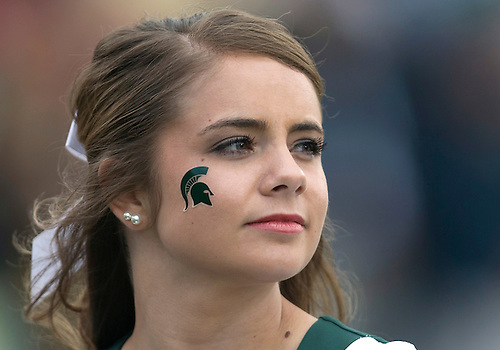 September 21, 2013:  Michigan State cheerleader during NCAA Football game action between the Notre Dame Fighting Irish and the Michigan State Spartans at Notre Dame Stadium in South Bend, Indiana.  Notre Dame defeated Michigan State 17-13.