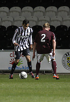 Mo Yaqub takes on Fraser Mullens in the St Mirren v Heart of Midlothian Clydesdale Bank Scottish Premier League U20 match played at St Mirren Park, Paisley on 6.11.12.