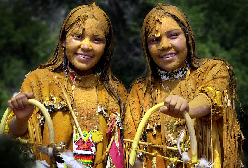 "SUNRISE CEREMONY Pollen-covered Fayreen and Farren are all smiles at their coming of age ceremony...Twelve year old Fayreen and Farren Holden, identical twins born 6 minutes apart, celebrated their coming of age last weekend with a four-day Apache Sunrise Ceremony.This age old ceremony initates young Apache women in to womenhood and prepares them for the long journey through life. The Double Ceremony was sponsored by mom, Joycelyn Holden and Nathaniel and Denise Cosay.Sunrise ceremonies are held on both the White Mountain and San Carlos Apache Reservations beginning in May and carry through into the fall each year and the ceremony is the ""coming of age"" puberty rite which has been celebrated by the Apache for centuries....."