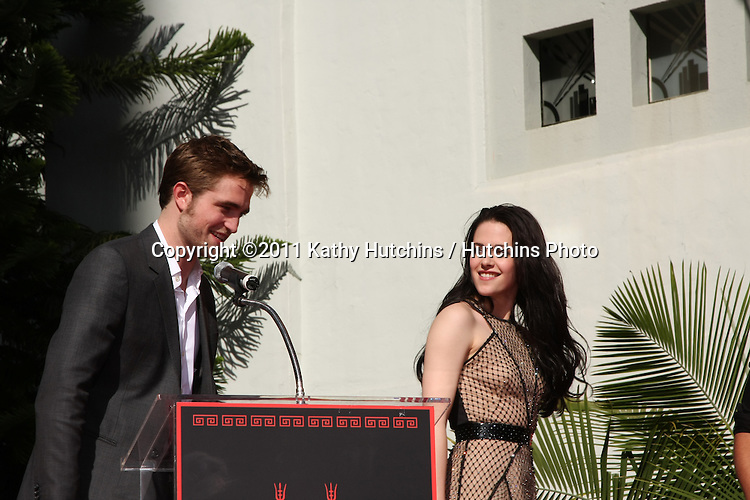 LOS ANGELES - NOV 3:  Robert Pattinson, Kristen Stewart at the Handprint and Footprint Ceremony for the Twilight Saga Actors at Grauman's Chinese Theater on November 3, 2011 in Los Angeles, CA