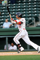 Second baseman Mauricio Dubon (10) of the Greenville Drive bats in a game against the Lexington Legends on Tuesday, April 14, 2015, at Fluor Field at the West End in Greenville, South Carolina. Lexington won, 5-3. (Tom Priddy/Four Seam Images)