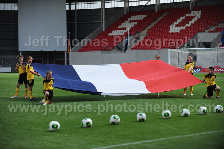 The French National flag is unveiled before the UEFA Womens U19 Semi-Final at Parc y Scarlets Wednesday 28th August 2013. All images are the copyright of Jeff Thomas Photography-www.jaypics.photoshelter.com-07837 386244-Any use of images must be authorised by the copyright owner.