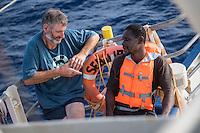 Sea Watch-2.<br /> Die Sea Watch-2 bei ihrer 13. SAR-Mission vor der libyschen Kueste.<br /> Die Sea Watch-2 hat am 22. Oktober 2016 knapp 200 Menschen an Bord aufgenommen. Sie mussten bis zum naechsten Tag auf dem Deck ausharren, bis ein Frontex-Schiff der spanischen Marine kam um sie nach Italien zu bringen.<br /> Im Bild: Ein Crew-Mitglied unterhaelt sich mit einem Mann aus Nigeria.<br /> 23.10.2016, Mediterranean Sea<br /> Copyright: Christian-Ditsch.de<br /> [Inhaltsveraendernde Manipulation des Fotos nur nach ausdruecklicher Genehmigung des Fotografen. Vereinbarungen ueber Abtretung von Persoenlichkeitsrechten/Model Release der abgebildeten Person/Personen liegen nicht vor. NO MODEL RELEASE! Nur fuer Redaktionelle Zwecke. Don't publish without copyright Christian-Ditsch.de, Veroeffentlichung nur mit Fotografennennung, sowie gegen Honorar, MwSt. und Beleg. Konto: I N G - D i B a, IBAN DE58500105175400192269, BIC INGDDEFFXXX, Kontakt: post@christian-ditsch.de<br /> Bei der Bearbeitung der Dateiinformationen darf die Urheberkennzeichnung in den EXIF- und  IPTC-Daten nicht entfernt werden, diese sind in digitalen Medien nach §95c UrhG rechtlich geschuetzt. Der Urhebervermerk wird gemaess §13 UrhG verlangt.]