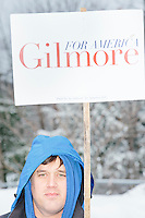 Virginia state director for  Former Virginia governor and Republican presidential candidate Jim Gilmore, Peter Foster holds a sign outside the polling station at Londonderry High School in Londonderry, New Hampshire, on the day of primary voting, Feb. 9, 2016. Gilmore finished in last place among major Republican candidates still in the race with a total of 150 votes.