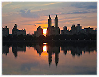 NEW YORK, NY - JUNE 26: Central Park resevoir at sunset looking at twin towers  in Yorkville, NY on June 26, 2013. Photo Credit: Thomas R Pryor
