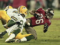 Receiver Karl Williams is tackled as his Tampa bay Buccaneers defeat the Green Bay Packers 29-10 December 26, 1999.  (Photo by Brian Cleary/www.bcpix.com)