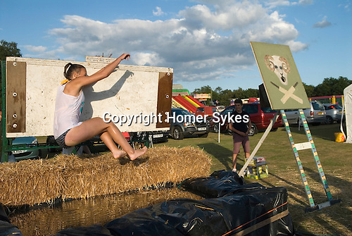 Ebernoe Horn Fair West Sussex UK 2015. Dunking platform. Contestants pay £1-00 for seven balls, and  try and get into the rams mouth, the girl then drops into the water.