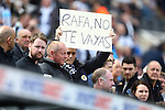 A Newcastle fan holds up a sign for Rafa Benitez in Spanish, asking him to stay, during the Barclays Premier League match at St James' Park. Photo credit should read: Philip Oldham/Sportimage