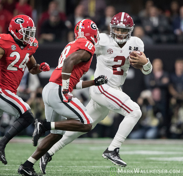 Alabama Crimson Tide quarterback Jalen Hurts (2) scrambles against Georgia Bulldogs defensive back Deandre Baker (18) in the first quarter of the NCAA College Football Playoff National Championship at Mercedes-Benz Stadium on January 8, 2018 in Atlanta. Photo by Mark Wallheiser/UPI