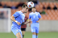 Houston, TX - Friday December 9, 2016: Alex Comsia (4) of the North Carolina Tar Heels heads the ball towards the Stanford Cardinal goal at the NCAA Men's Soccer Semifinals at BBVA Compass Stadium in Houston Texas.