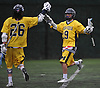 James Hall #19 of Massapequa, right, congratulates teammate #26 Ryan Tierney after he scored a goal in a Nassau County varsity boys lacrosse game against Syosset at Syosset-Woodbury Community Park on Tuesday, May 3, 2016. Tierney scored five goals in defeat as Syosset won by a score of 13-12.