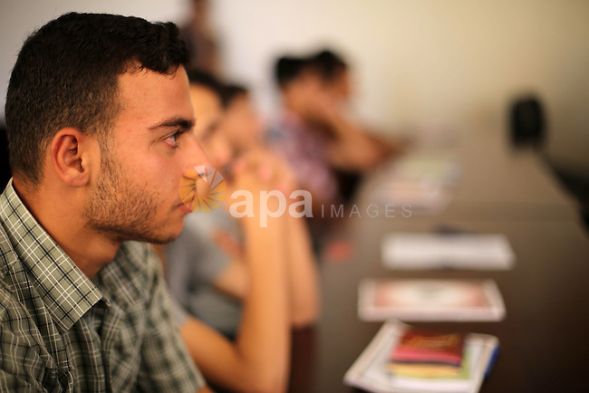 Palestinian deaf students react during A Palestinian imam uses sign-language to teach them the Koran, Islam's holy book at a religion school in Gaza City on June 21 2016, during the Muslim fasting month of Ramadan. Photo by Mohammed Asad