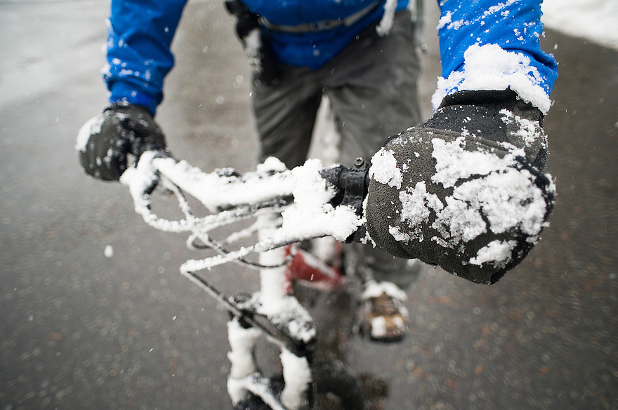 Snow and cold temperatures are part of cycling in Yellowstone during the spring biking season.