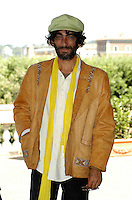 """GIOVANNI MARTORANA.Photcall for the film """"Io, l'altro"""", Campidoglio, Rome, Italy..May 10th, 2007.half length brown beige leather jacket yellow scarf green hat hand in pocket beard facial hair .CAP/CAV.©Luca Cavallari/Capital Pictures"""