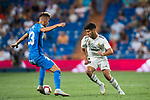Marco Asensio Willemsen (R) of Real Madrid tackles Ivan Alejo Peralta of Getafe CF during the La Liga 2018-19 match between Real Madrid and Getafe CF at Estadio Santiago Bernabeu on August 19 2018 in Madrid, Spain. Photo by Diego Souto / Power Sport Images