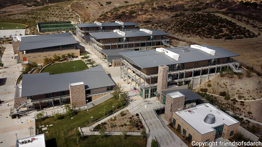 Sage Creek High School, a High Performance School, Carlsbad, CA, 2013.At the edge of a nature preserve, the new campus is terraced on a hillside, The eastern portions of the 56 acre site remain undisturbed to create a seamless transition to the adjacent native landscape. The campus bioswale is re-aligned to flow across the campus and maintain the original drainage pattern through the site.<br /> Chikako Terada, Architect.