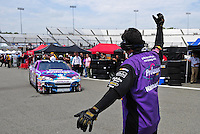 May 1, 2009; Richmond, VA, USA; NASCAR Sprint Cup Series driver Jeff Burton is directed into his garage by a crew member during practice for the Russ Friedman 400 at the Richmond International Raceway. Mandatory Credit: Mark J. Rebilas-