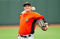 Pitcher Justin Moore #29 of the Frederick Keys warms up in the outfield prior to the game against the Winston-Salem Dash at BB&T Ballpark on August 5, 2011 in Winston-Salem, North Carolina.  The Dash defeated the Keys 10-0.   Brian Westerholt / Four Seam Images