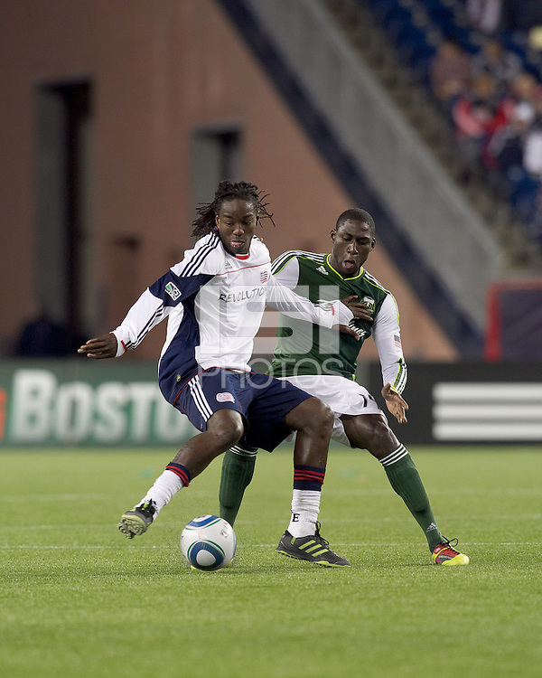 New England Revolution midfielder Shalrie Joseph (21) controls the ball as Portland Timbers midfielder James Marcelin (14) pressures. In a Major League Soccer (MLS) match, the New England Revolution tied the Portland Timbers, 1-1, at Gillette Stadium on April 2, 2011.