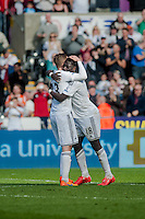 SWANSEA, WALES - APRIL 04: Bafetimbi Gomis of Swansea City  Celebrates during the Premier League match between Swansea City and Hull City at Liberty Stadium on April 04, 2015 in Swansea, Wales.  (photo by Athena Pictures)