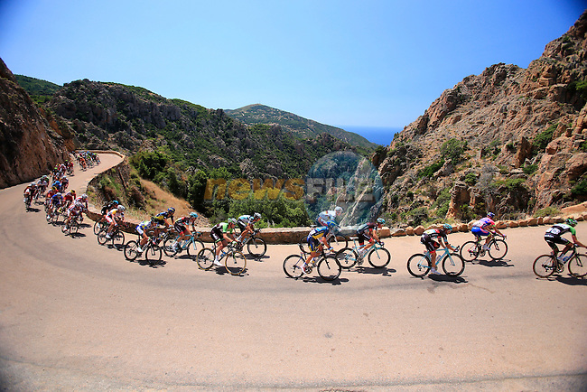 The peleton pass through the Unesco site of Les Calanches during Stage 3 of the 100th Edition of the Tour de France 2013 from Ajaccio to Calvi.<br /> (Photo: Eoin Clarke/ www.newsfile.ie)