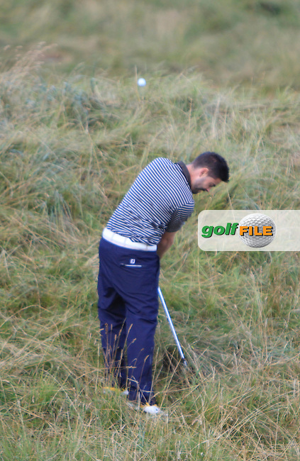 Sean Ryan (The Royal Dublin) in the rough on the 13th during the South of Ireland Amateur Open Championship Third Round at Lahinch Golf Club  29th July 2013 <br /> Picture:  Thos Caffrey / www.golffile.ie