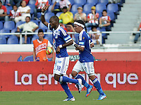 BARRANQUIILLA -COLOMBIA-27-10-2013. Wason Renteria (I) de Millonarios celebra un gol en contra de Atlético Junior durante partido válido por la fecha 16 de la Liga Postobón II 2013 jugado en el estadio Metropolitano Roberto Meléndez de la ciudad de Barranquilla./ Millonarios player Wason Renteria (L)celebrates a goal against  Atletico Junior during match valid for the 16th date of the Postobon League II 2013 played at Metropolitano Roberto Melendez stadium in Barranquilla city.  Photo: VizzorImage/Gabriel Aponte/STR