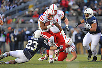 23 November 2013:  Nebraska RB Ameer Abdullah (8) jumps over a tackle by Penn State S Ryan Keiser (23). The Penn State Nittany Lions vs. the Nebraska Cornhuskers at Beaver Stadium in State College, PA.