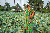 Vegetable farmer Sawan Kumari, a member of a Farmer's Producer Group, poses for a portrait in her cauliflower farm in Machahi village, Muzaffarpur, Bihar, India on October 26th, 2016. Non-profit organisation Technoserve works with women vegetable farmers in Muzaffarpur, providing technical support in forward linkage, streamlining their business models and linking them directly to an international market through Electronic Trading Platforms. Photograph by Suzanne Lee for Technoserve