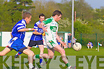 Paul Kennelly of Ballydonoghue scores the opening goal as Renard's Finan Kissane looks on last Saturday night in Ballydonoghue.