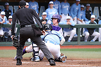 CHAPEL HILL, NC - FEBRUARY 19: Eric Grintz #5 of the University of North Carolina tags Cole Singsank #16 of High Point University out at home plate during a game between High Point and North Carolina at Boshamer Stadium on February 19, 2020 in Chapel Hill, North Carolina.