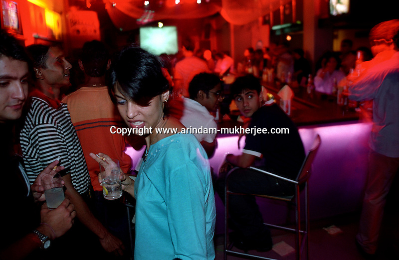 A woman having alcohol at a nightclub in Kolkata, India. Of late, incidents of molestation have increased, in and outside the nightclubs where women are more vulnerable after alcohol consumption. Crimes against women have been going on since centuries. In India, women have been categorically marginalized with various types of repressions enforced upon them. Be it home or outside, an Indian woman is potentially at the risk of being discriminated against, molested, raped and even killed. Until recently, turning a blind eye to such crimes has been the norm in largely gender-biased Indian society. But after the brutal gang rape and subsequent death of the Delhi Physiotherapy student, the so-far-silent middle class has turned vocal. .