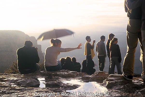 TOURISTS VIEW THE GRAND CANYON ON A RAINY DAY