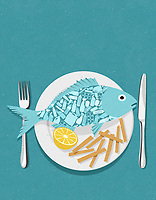 Fish full of plastic on plate with ExclusiveImage
