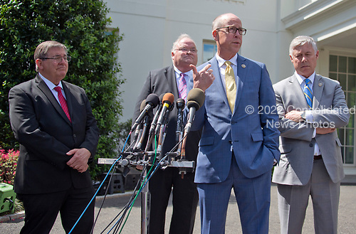 United States Representative Greg Walden (Republican of Oregon), Chairman of the US House Energy and Commerce Committee, announces his support for the GOP health care plan at the White House in Washington, DC following a meeting with US President Donald J. Trump and other members of the Republican Caucus on Wednesday, May 3, 2017.  From left to right: US Representative Michael Burgess (Republican of Texas),  US Representative Billy Long (Republican of Missouri), Chairman Walden, and US Representative Fred Upton (Republican of Michigan).<br /> Credit: Ron Sachs / CNP