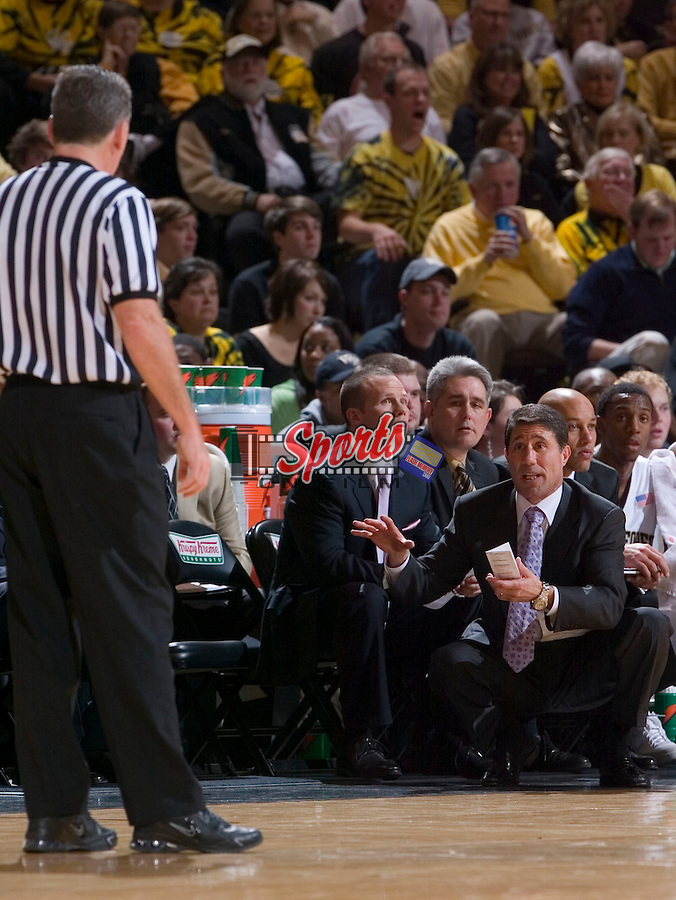 WINSTON-SALEM, NC - JANUARY 11:  Wake Forest Demon Deacons head coach Dino Gaudio discusses a call with referee Jamie Luckie during first half action versus the North Carolina Tar Heels at the LJVM Coliseum January 11, 2009 in Winston-Salem, North Carolina.  The Demon Deacons defeated the Tar Heels 92-89.  (Photo by Brian Westerholt / Sports On Film)