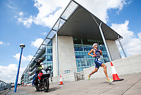 08 AUG 2010 - LONDON, GBR - Courtney Atkinson races the last few yards to his final turnaround in front of Building 1000 on his way to victory in the Elite Mens race at the  2010 Challenger World London Triathlon (PHOTO (C) NIGEL FARROW)
