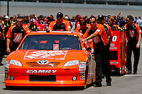 19 June, 2011: The number 20 Home Depot car of Joey Logano is rolled out into position prior to qualifying for the 43rd Annual Heluva Good! Sour Cream Dips 400 at Michigan International Speedway in Brooklyn, Michigan. (Photo by Jeff Speer :: SpeerPhoto.com)