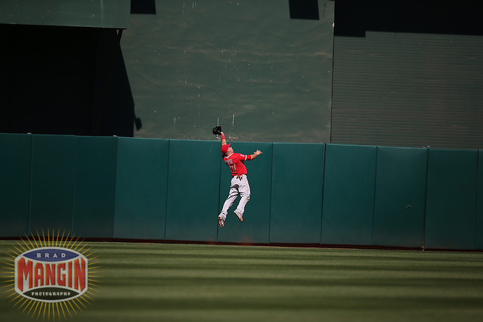 OAKLAND, CA - APRIL 30:  Mike Trout #27 of the Los Angeles Angels makes a leaping catch in centerfield with two outs in the bottom of the 9th inning on a fly ball off the bat of Oakland Athletics batter Ike Davis #17 at O.co Coliseum on Thursday, April 30, 2015 in Oakland, California. The catch came with the bases loaded and saved the game for the Angels who won by a final score of 6-5. Photo by Brad Mangin