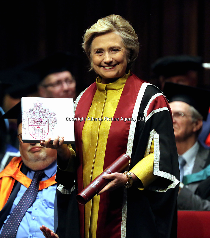 Pictured: Hillary Clinton is handed a commemorative book about her family history at Swansea University Bay Campus. Saturday 14 October 2017<br /> Re: Hillary Clinton, the former US secretary of state and 2016 American presidential candidate will be presented with an honorary doctorate during a ceremony at Swansea University's Bay Campus in Wales, UK, to recognise her commitment to promoting the rights of families and children around the world.<br /> Mrs Clinton's great grandparents were from south Wales.