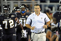 25 October 2011:  FIU Football Head Coach Mario Cristobal leads his team onto the field prior to the game.  The FIU Golden Panthers defeated the Troy University Trojans, 23-20 in overtime, at FIU Stadium in Miami, Florida.