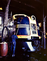 Bath Time: Washing one of the Santa Fe R.R. 54 hundred horse power diesel freight locomotives in the roundhouse, Argentine, Kansas. Argentine yard is at Kansas City, Kansas, March 1943.<br /> <br /> Photo by Jack Delano.