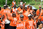 Participants walk in the Wear Orange Day March against gun violence on North Grand Boulevard on Saturday June 2, 2018. June is National Gun Violence Awareness Month.<br /> Photo by Tim Vizer