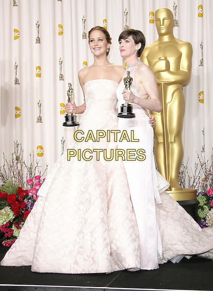 Jennifer Lawrence, Anne Hathaway .85th Annual Academy Awards held at the Dolby Theatre at Hollywood & Highland Center, Hollywood, California, USA..February 24th, 2013.pressroom oscars full length white award trophy trophies winner winners white pink pale strapless dress trophies winners .CAP/ADM.©AdMedia/Capital Pictures.