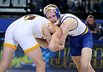 BROOKINGS, SD - JANUARY 18: Colten Carlson from South Dakota State University tries to gain control of Sam Turner from Wyoming during their 149 pound match Thursday night at Frost Arena in Brookings. (Photo by Dave Eggen/Inertia)